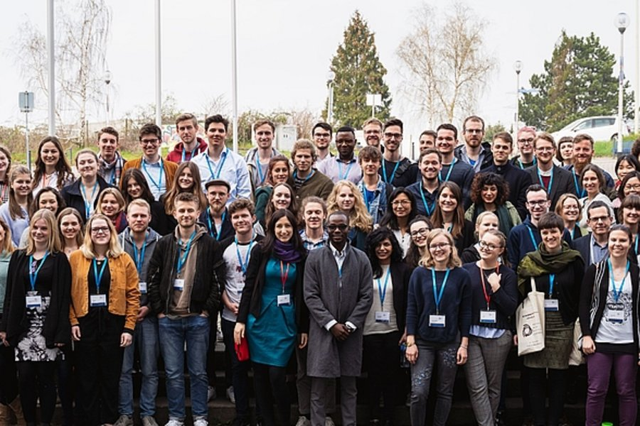 All attendees of the PPE Conference 2019 gather for a group picture in front of the University